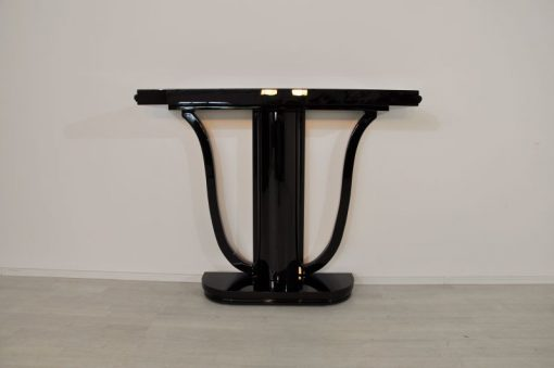 Art Deco, Konsole, hochglanzschwarzer Klavierlack, geschwungene Formensprache, simples Design, edeles Exterior, Wandkonsole